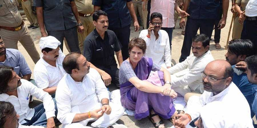 AICC General Secretary Priyanka Gandhi Vadra stopped illegally near Narayanpur Police Station in Mirzapur. She sits on protest at road in Mirzapur after being stopped from proceeding to Sonbhadra.
