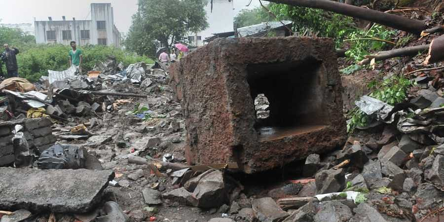 Rescue team at the site where a wall of Singhad Institute collapsed on the makeshift shelters of labourers at Ambegaon area in Pune on 2 July 2019. (Photo | PTI)