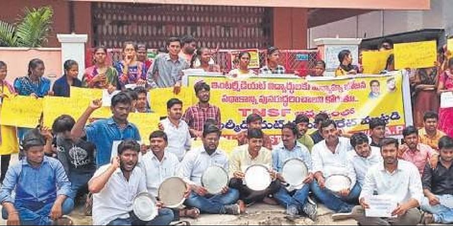 TNSF students stage protest in front of the Office of the Commissionerate of Intermediate Education in Guntur on Friday.