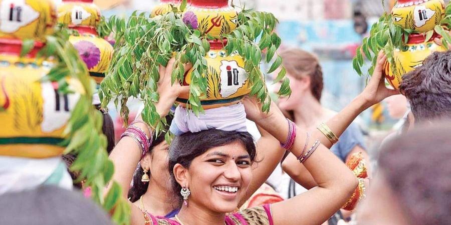 Youths soak in Bonalu spirit