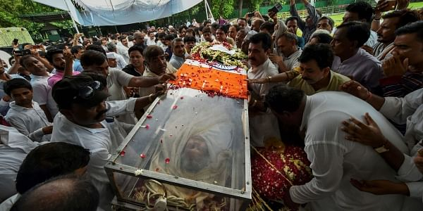 Congress workers carry the mortal remains of former Delhi chief minister Sheila Dikshit at the AICC headquarters in New Delhi Sunday July 21 2019.  | PTI