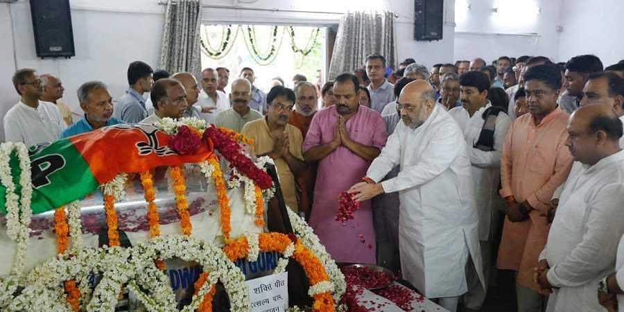 BJP chief Amit Shah pays tribute to former Delhi BJP chief Mange Ram Garg at Delhi Pradesh office on 21J July 2019. (Photo   Arun Kumar, EPS)