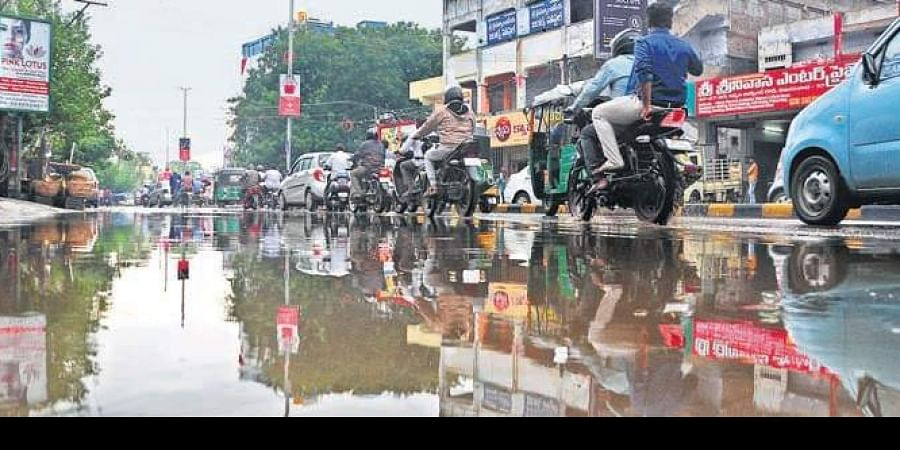 Nirmala Convent Road in Vijayawada inundated after rain lashed the city on Saturday.