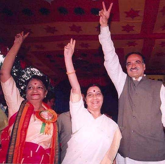 Senior BJP leader and former Delhi CM Sushma Swaraj waving at the crowd during in an election campaign in Bangalore. Chamarajpet BJP candidate Pramila Nesargi and BJP National General Secretary Anantha Kumar are also seen.