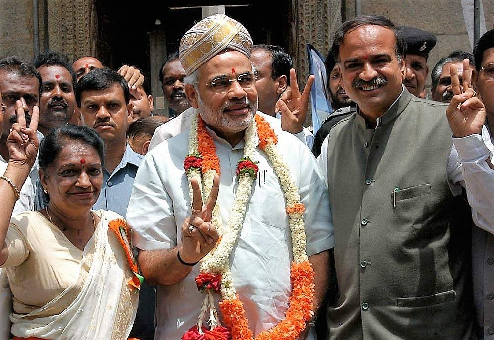 Then Gujarat CM Narendra Modi (C), BJP National Secretary, H N Ananth Kumar and Chamarjpet constituency candidate Pramila Nesargi showing the victory sign after offering pooja at Dharmaraya Temple before attending a public meet for campaigning.