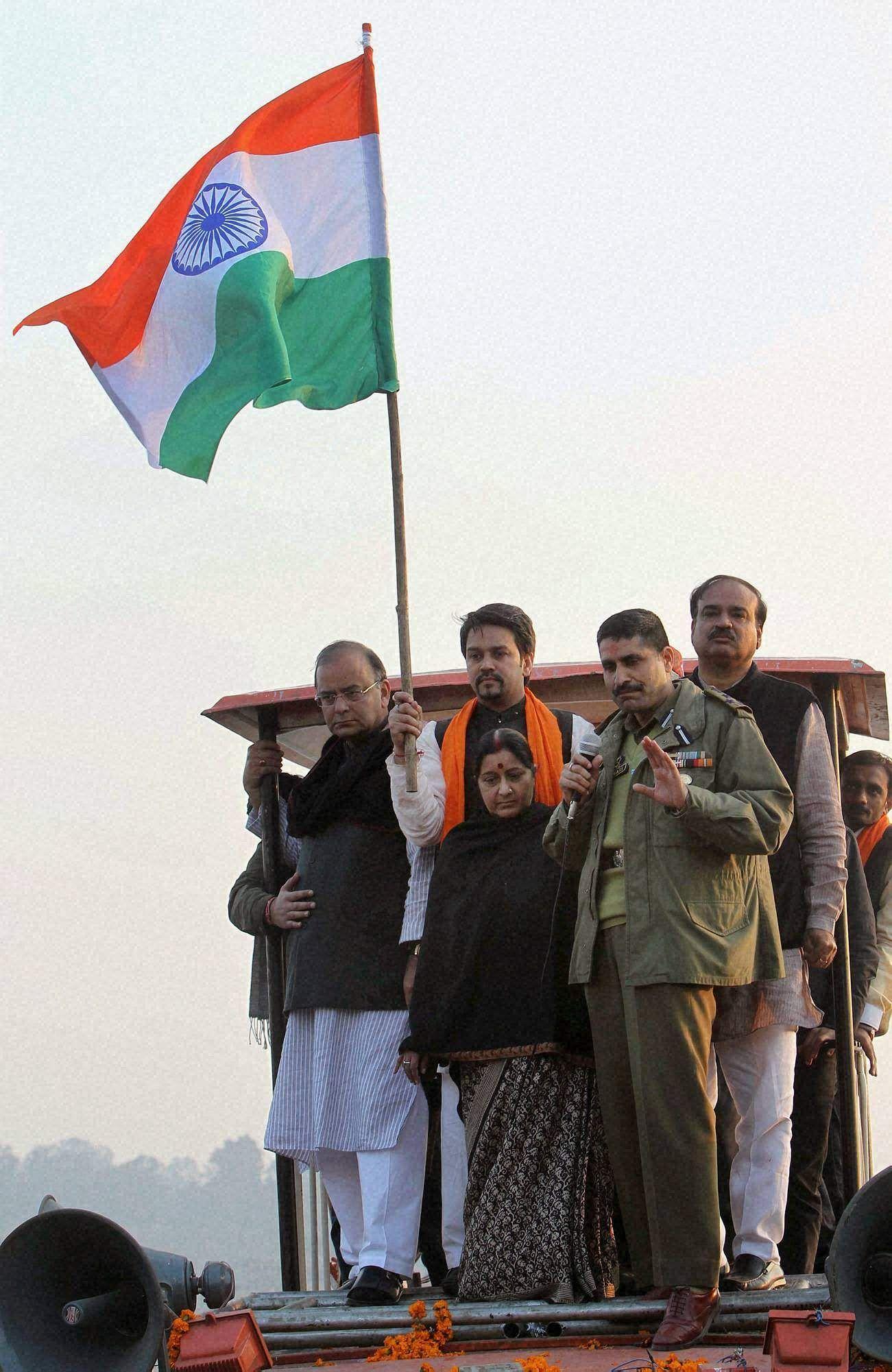 A police officer announces the arrest of BJP leaders Sushma Swaraj, Arun Jaitley, Ananth Kumar and Bhartiya Janata Yuva Morcha president Anurag Takhur during the party Rashtriya Ekta Yatra at Madhavpur along Jammu-Punjab border.