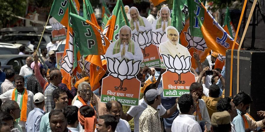 BJP supporters participate in a victory rally.