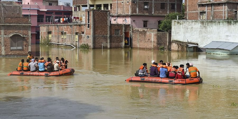 Residents being rescued from a flooded area in Sitamarhi, Bihar.