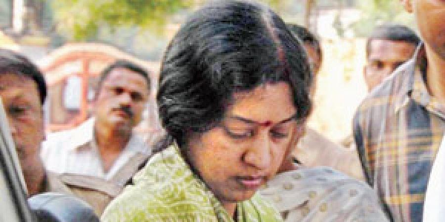 Senior IAS officer Y Srilakshmi being escorted into the Chanchalguda women's prison