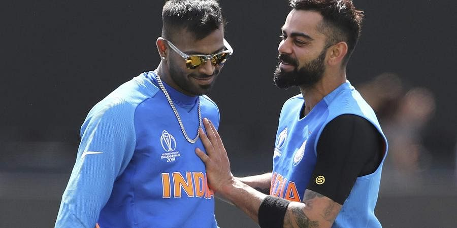 India's captain Virat Kohli, right, shares a light moment with teammate Hardik Pandya during a training session. (Photo | AP)