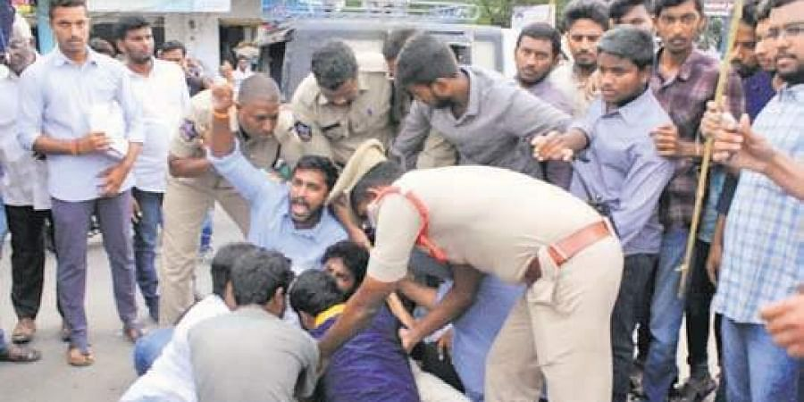 Telugu Nadu Students Federation (TNSF) workers being arrested by the police for burning the effigy of CM Jagan Mohan Reddy in Guntur