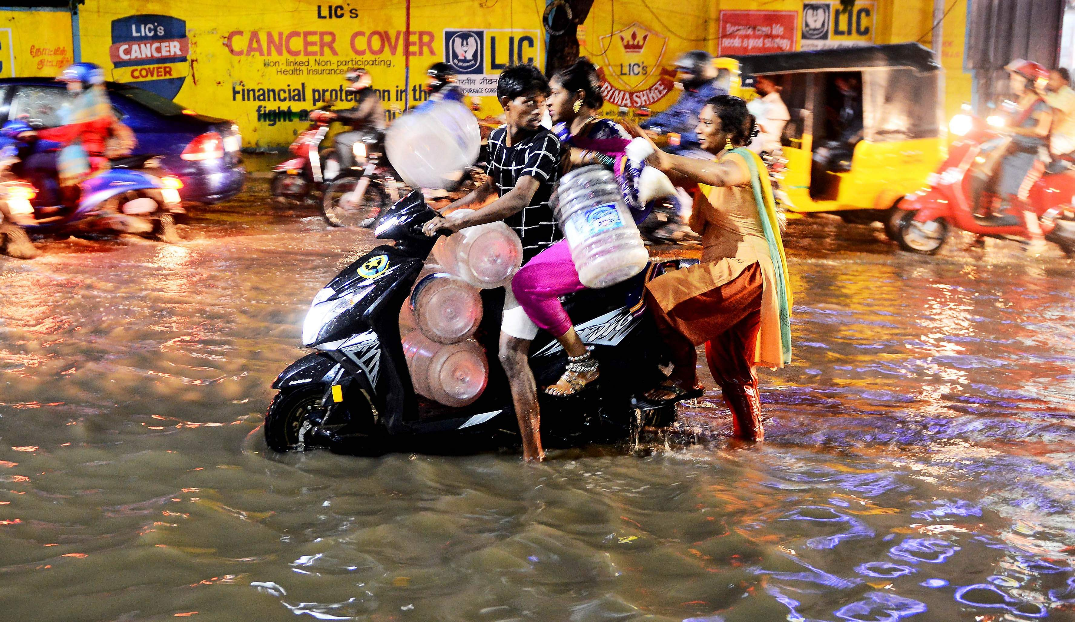 Residents of parched Chennai brave waterlogged roads to fetch water for their needs. (Photo | Debadatta Mallick, EPS)