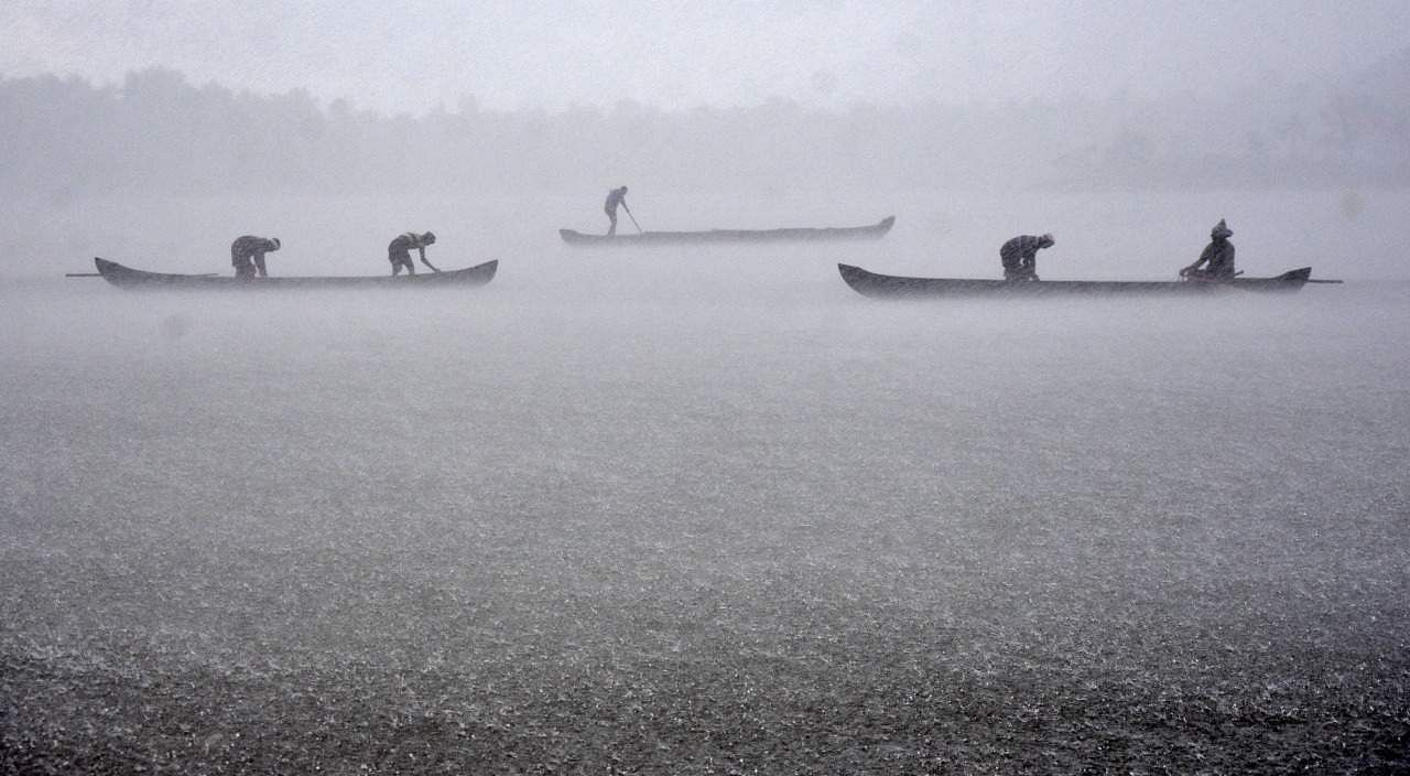 Inland fishermen struggle to keep their boats from toppling in the strong winds, following heavy rains that lashed Perunguzhi in Thiruvananthapuram, Kerala. (Photo | B P Deepu, EPS)