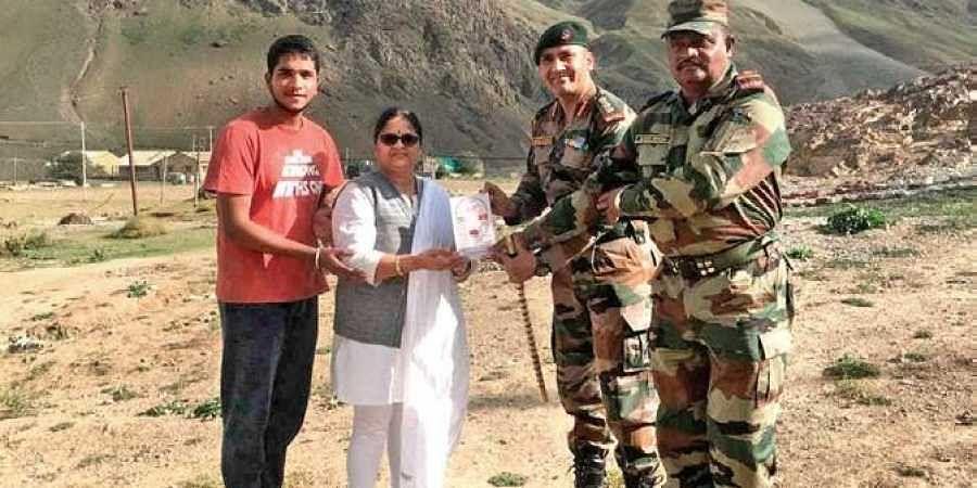 Nibedita and son Soumyaranjan being presented a memento by officers of 12th Mahar at Drass in Kargil