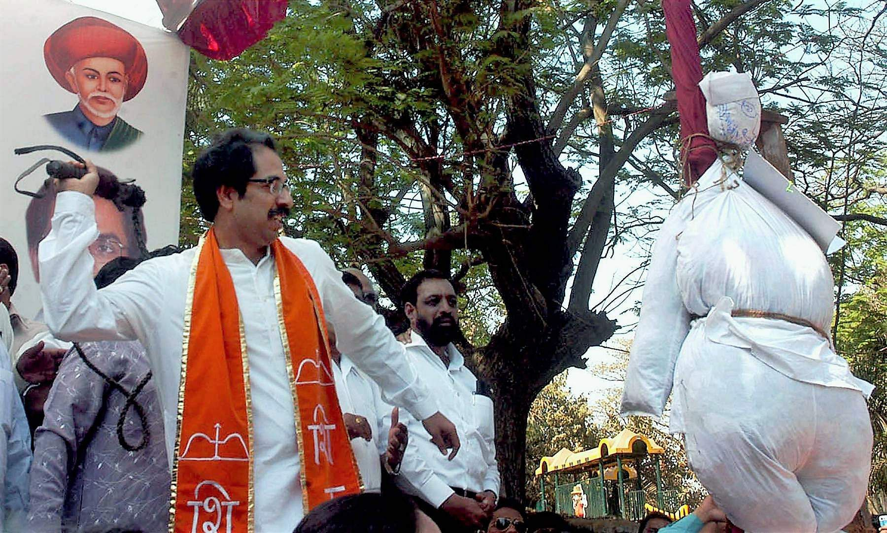 2008: Then Shiv Sena executive president Uddhav Thackeray, lashing an effigy symbolising the Maharashtra Government as part of party campaign for complete loan waiver for farmers, outside the party office at Shivaji Park in Mumbai.