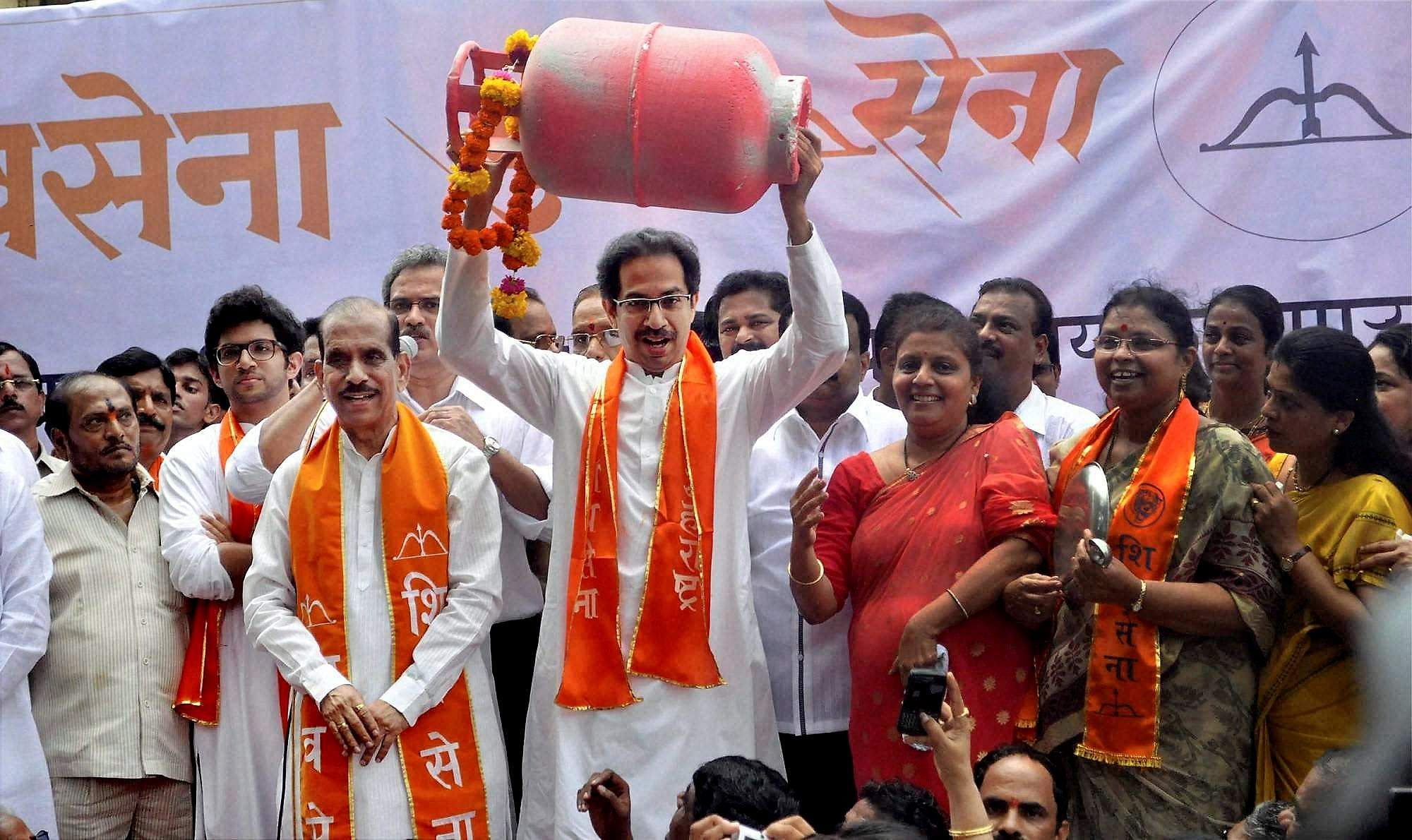 2012: Shiv Sena leaders Uddhav Thackeray and Manohar Joshi during a protest against the hike in the prices of LPG cylinders in Mumbai.
