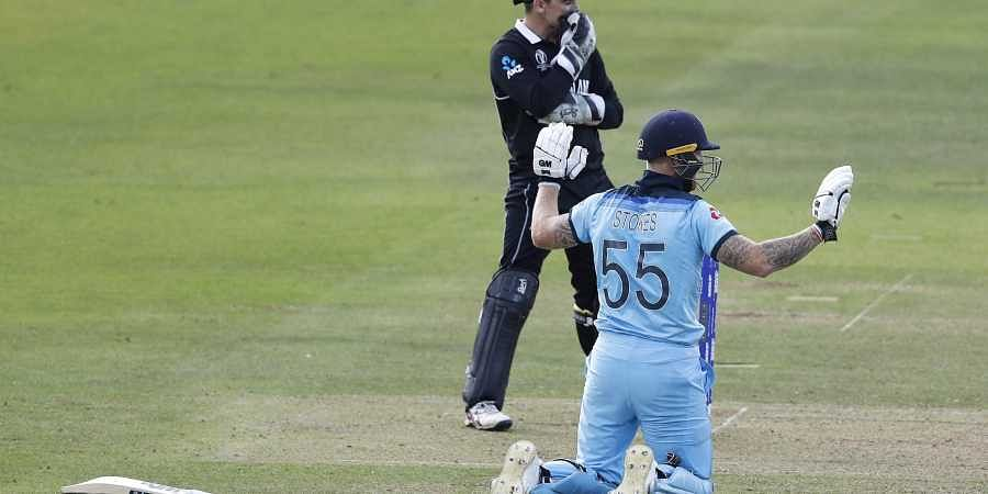 England's Ben Stokes holds up his hands apologetically after get a 6 from overthrows during the Cricket World Cup final match between England and New Zealand at Lord's cricket ground in London.