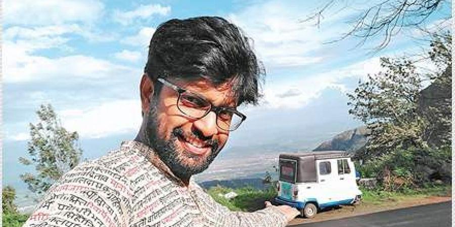 Naufar Jaleel posing with his autorickshaw