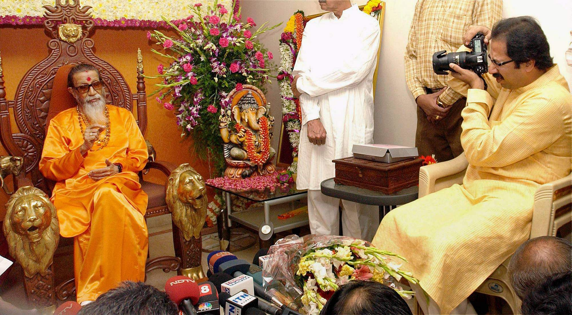 2008: Then Shiv Sena executive president Uddhav Thackeray is seen taking a snap of his father and party supremo Bal Thackeray, who turned 82, celebrated birthday at their residence Mathoshri.