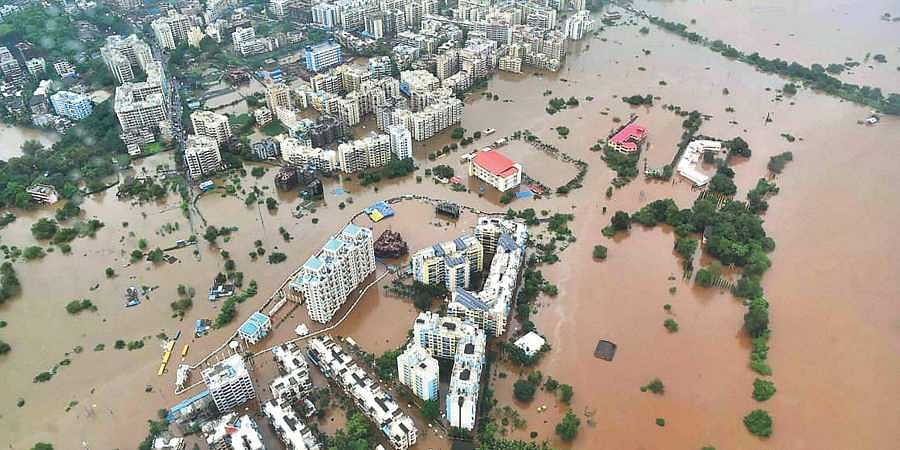 A bird's eye view shows a flooded area in Thane district following heavy rains on Saturday