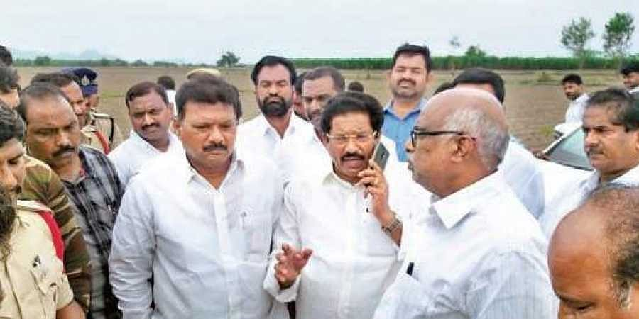 Members of the Telugu Desam Party (TDP) fact-finding committee who were taken into custody by the police after being stopped from entering Ponugupadu village in Guntur distri