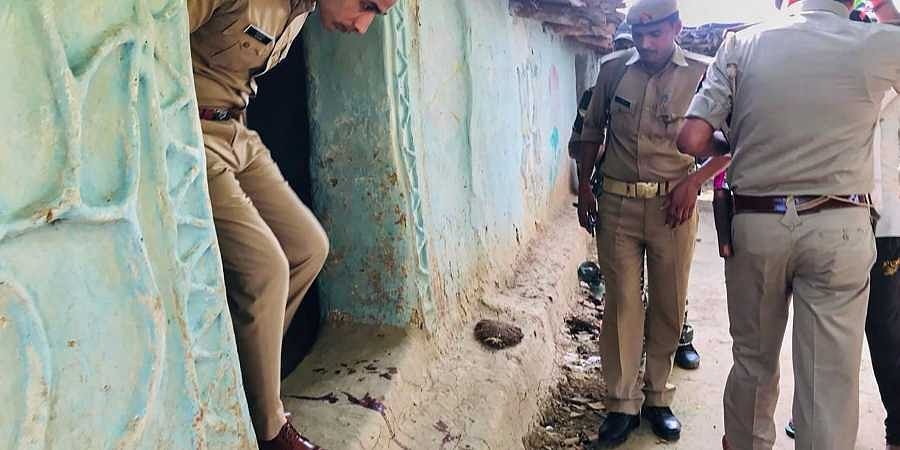 Sonbhadra S P Salman Taj Patil visits the house of a victim killed over a property dispute in Sonbhadra district Wednesday July 17 2019.