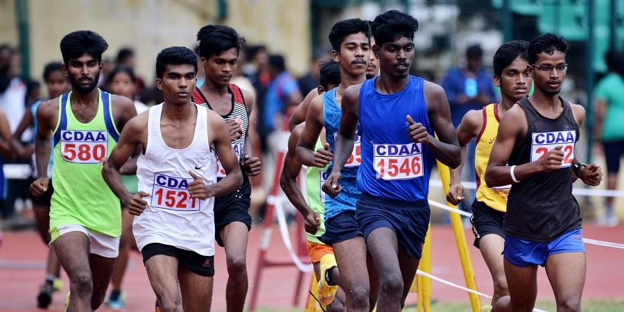 Students participating in the 5000-metre race during the 50th anniversary of Chennai Junior Athletic Championship at Nehru Stadium on 26 July 2019. (Photo | D Sampathkumar, EPS)