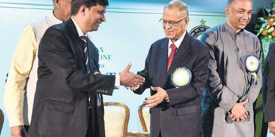 Left to right: Principal Chief Commissioner Nagendra Kumar and Infosys co-founder N R Narayana Murthy during GST Day 2019  in Bengaluru on Monday. SELCO co-founder Dr Harish Hande was also present
