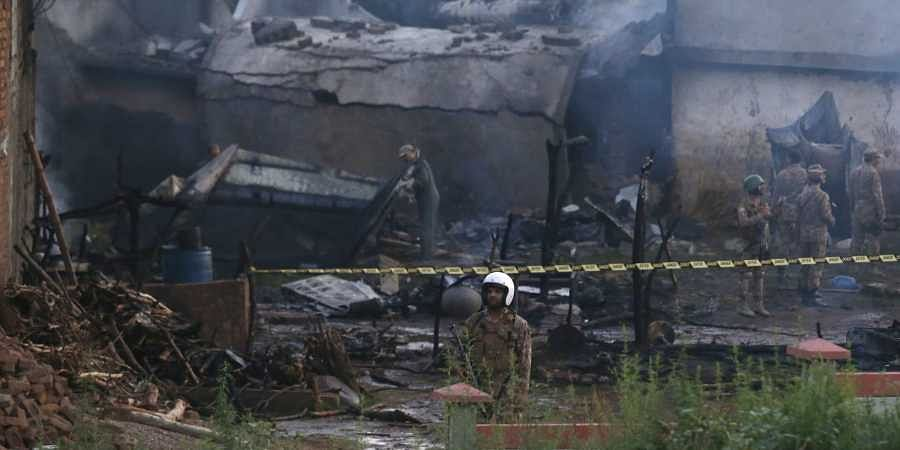17 killed as Pakistani army plane crashes into residential area- The