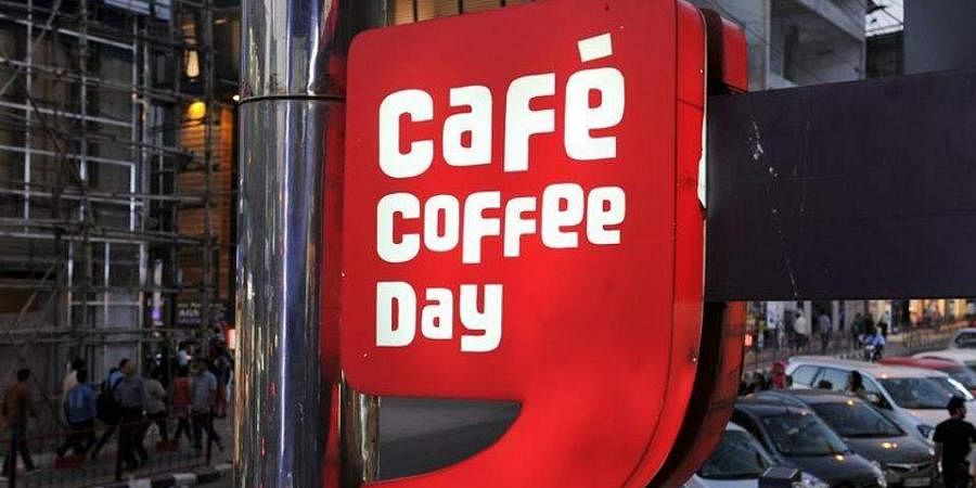 The Cafe Coffee Day logo board is seen outside one of its outlet
