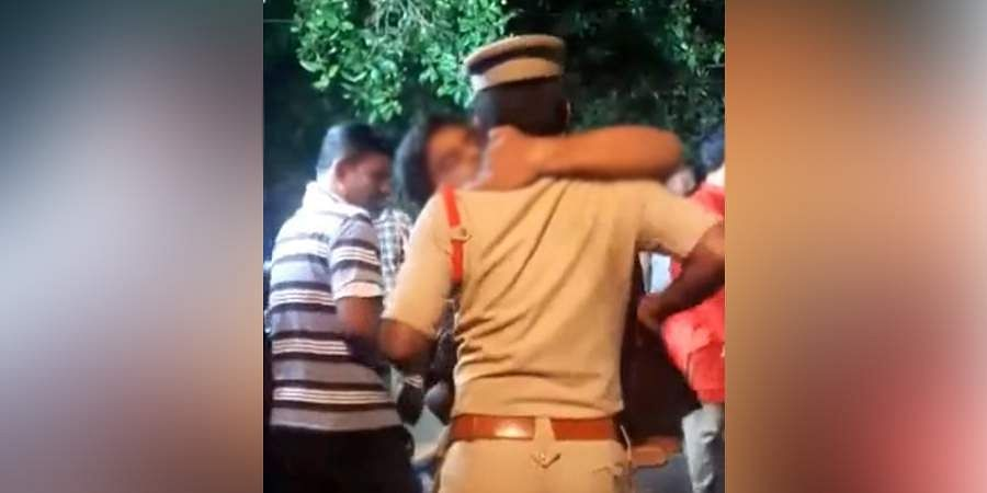 man hugs and kisses a police official