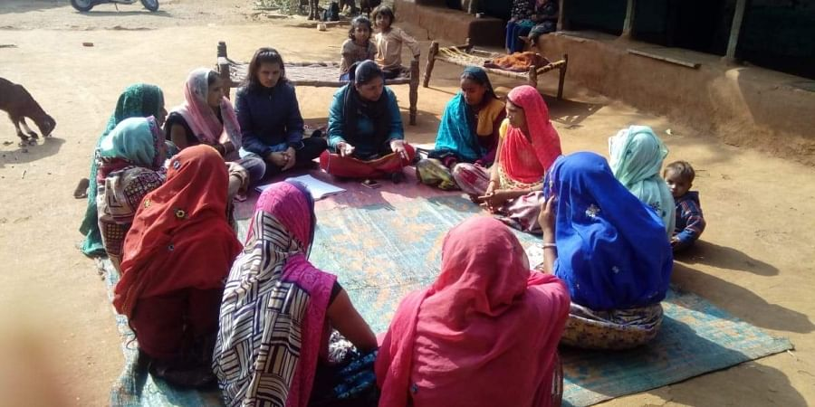 Women  discuss various issues in a panchayat session in a village in Rajasthan