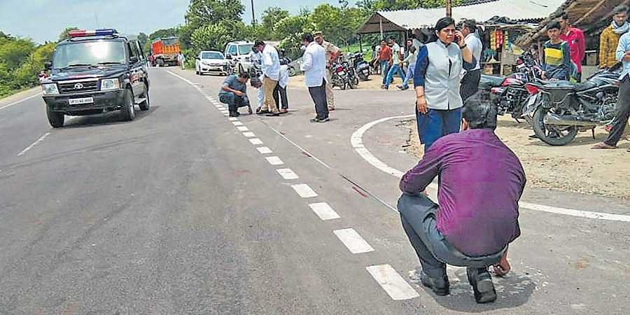 Police officers inspect the site of the accident near Rae Bareli where the Unnao rape survivor and her lawyer were injured, while her aunts died