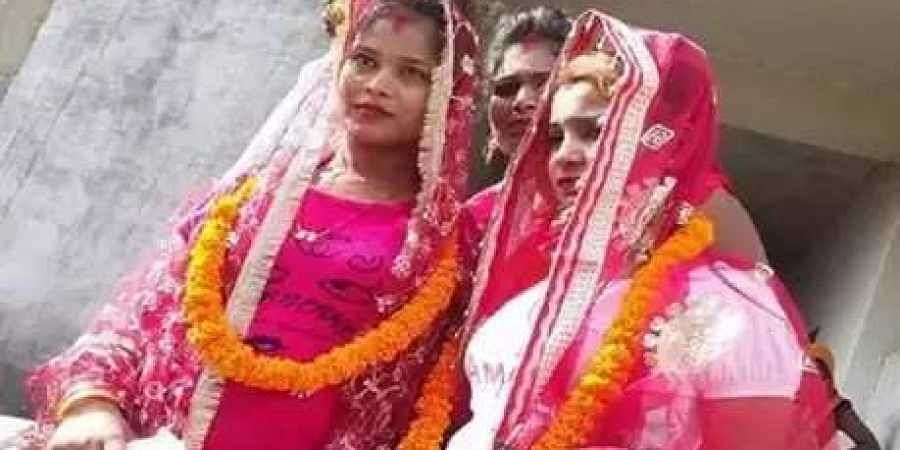 The two cousins pose for a picture after marriage