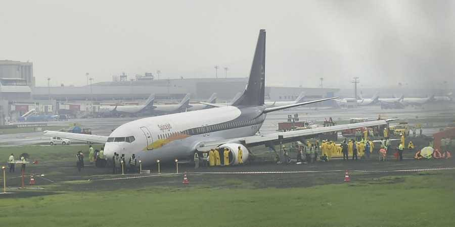 A SpiceJet plane from Jaipur overshot the runway while landing at Mumbai airport amid heavy rain on Monday in Mumbai