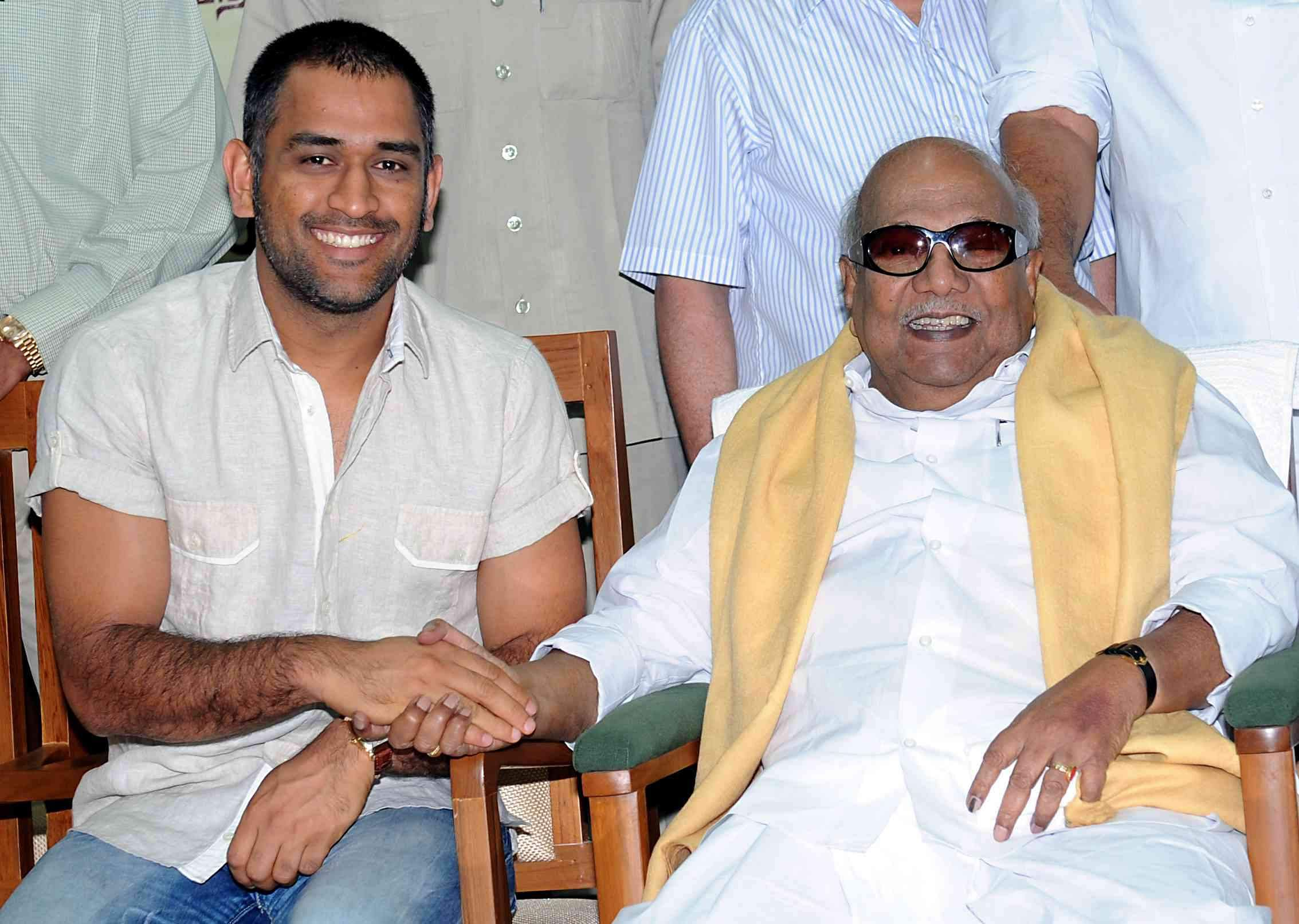 Then Tamil Nadu CM Karunanidhi hakes hands with skipper MS Dhoni at a function.