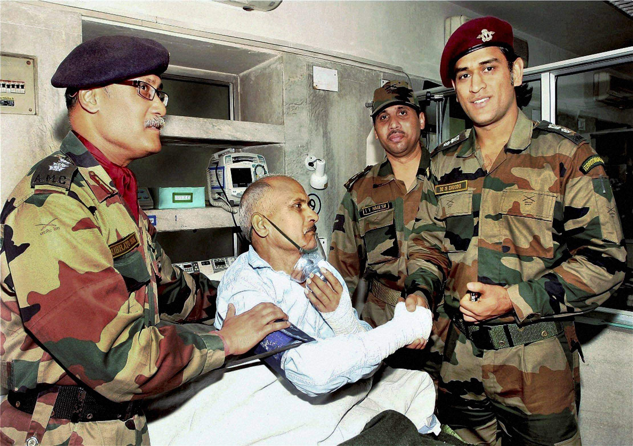 Lieutenant Colonel MS Dhoni, Indian cricket captain interacting with a patient at 92 Base Hospital in Srinagar.
