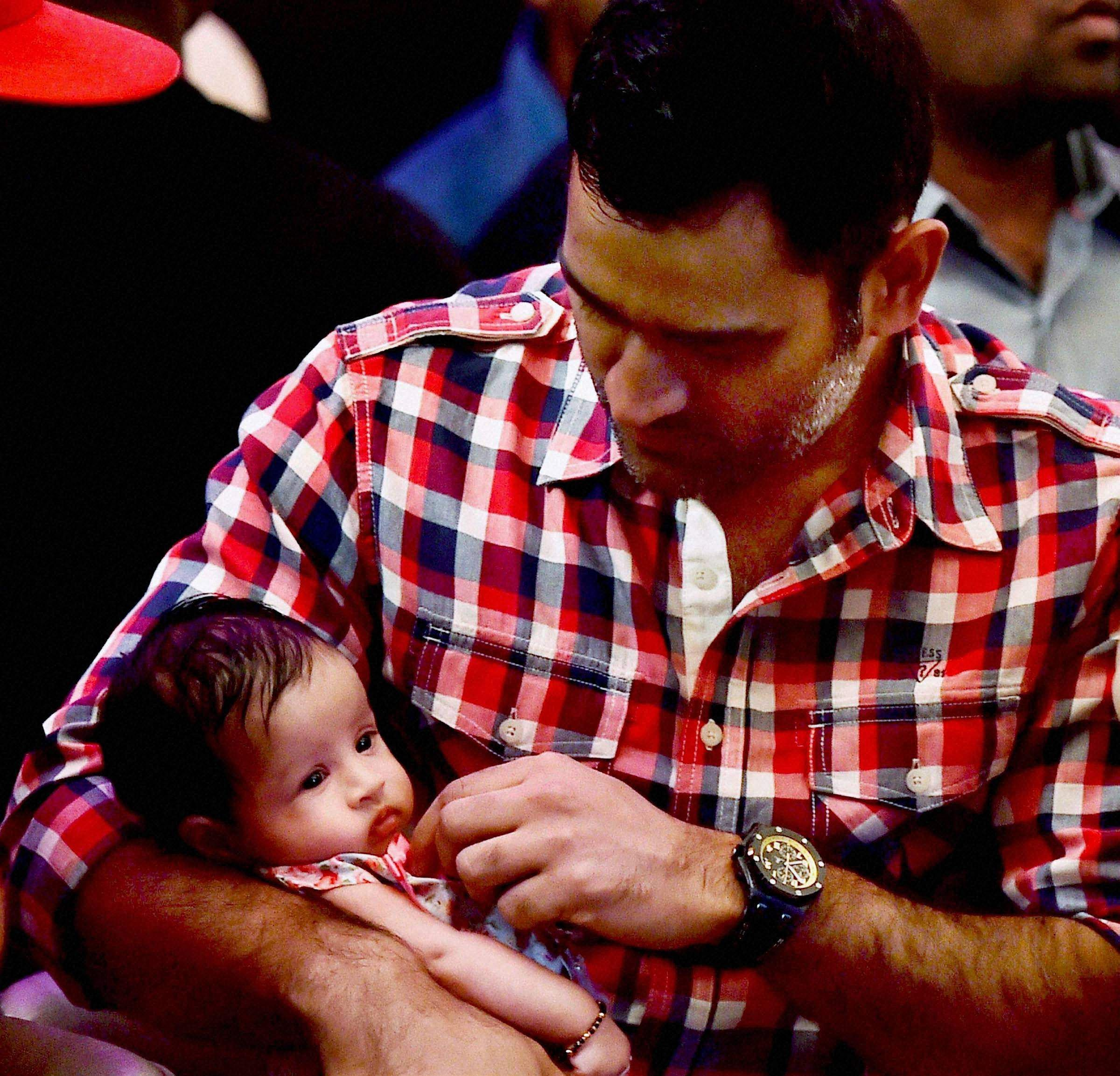 MS Dhoni with his daughter at an event in Chennai.