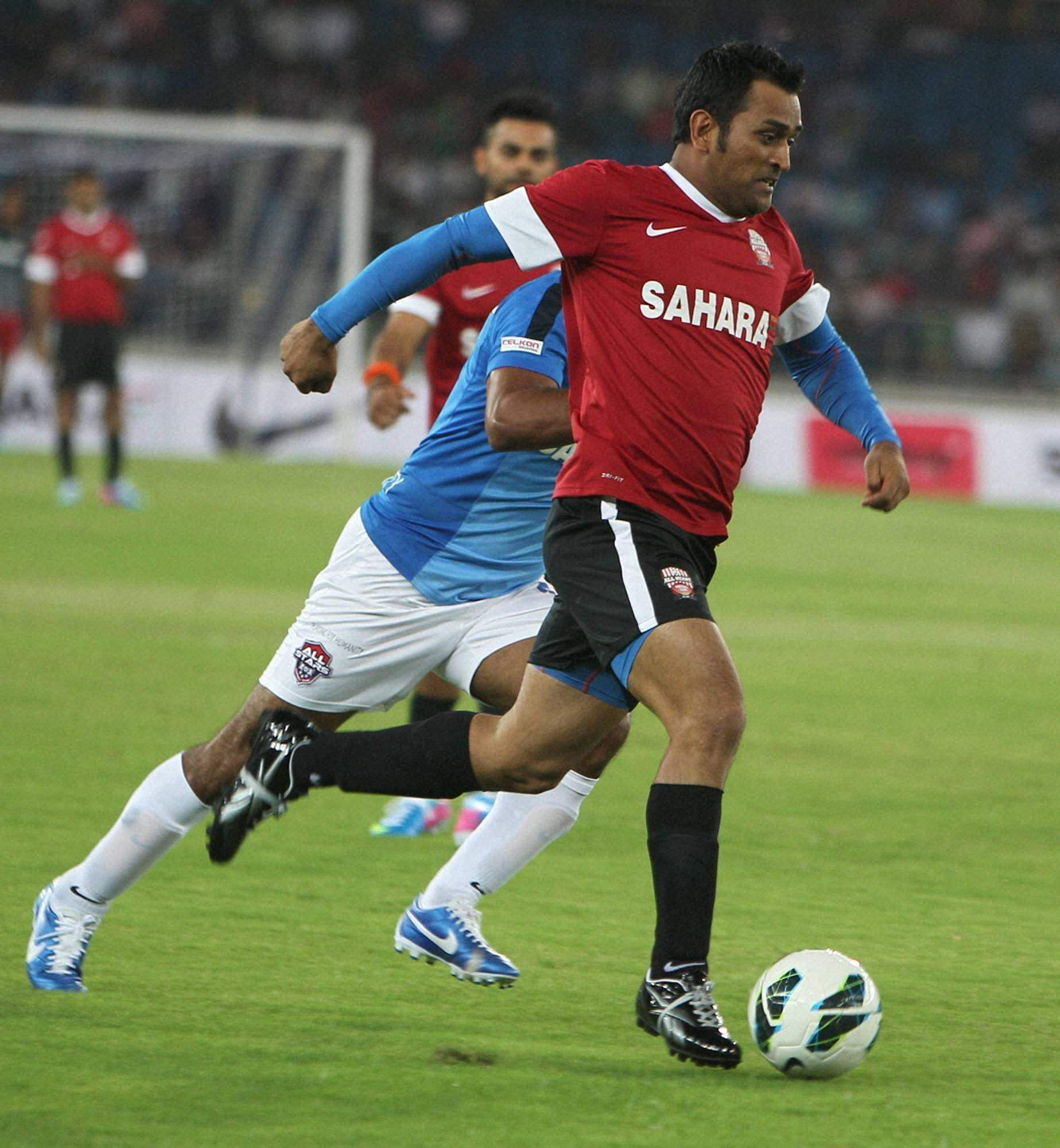Dhoni during a celebrity football match organised by Virat Kohli charity foundation All heart football club at JLN stadium.