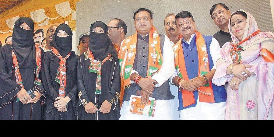 BJP national general secretary Kailash Vijayvargiya with new members at the launch of BJP nationwide membership campaign, in Bhopal, Saturday.