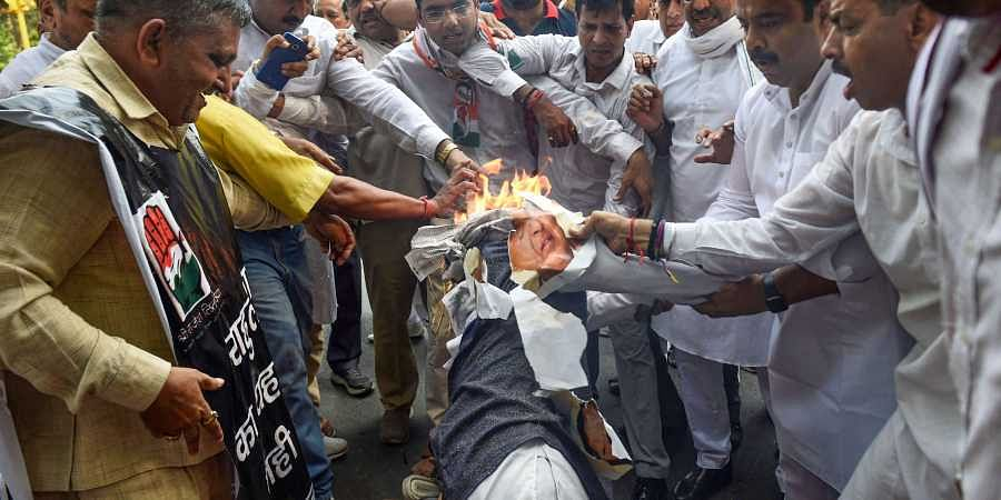 Congress supporters burn an effigy of BJP leader Subramanian Swamy during a protest against his remarks over Rahul Gandhi outside his residence in New Delhi on 7 July 2019. (Photo | PTI)