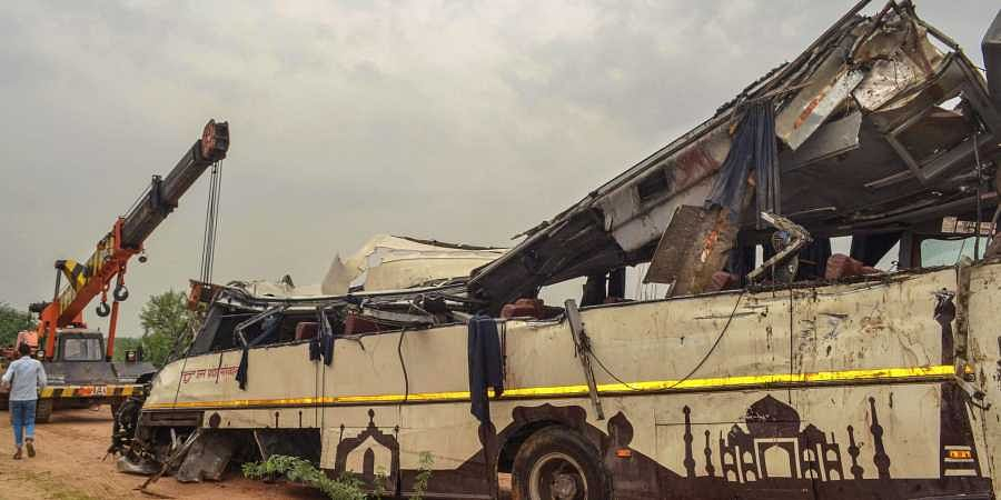 The mangled remains of a bus are seen after it skidded off the six-lane Yamuna Expressway and fell into a large drain near Agra on 8 July 2019. (Photo | PTI)