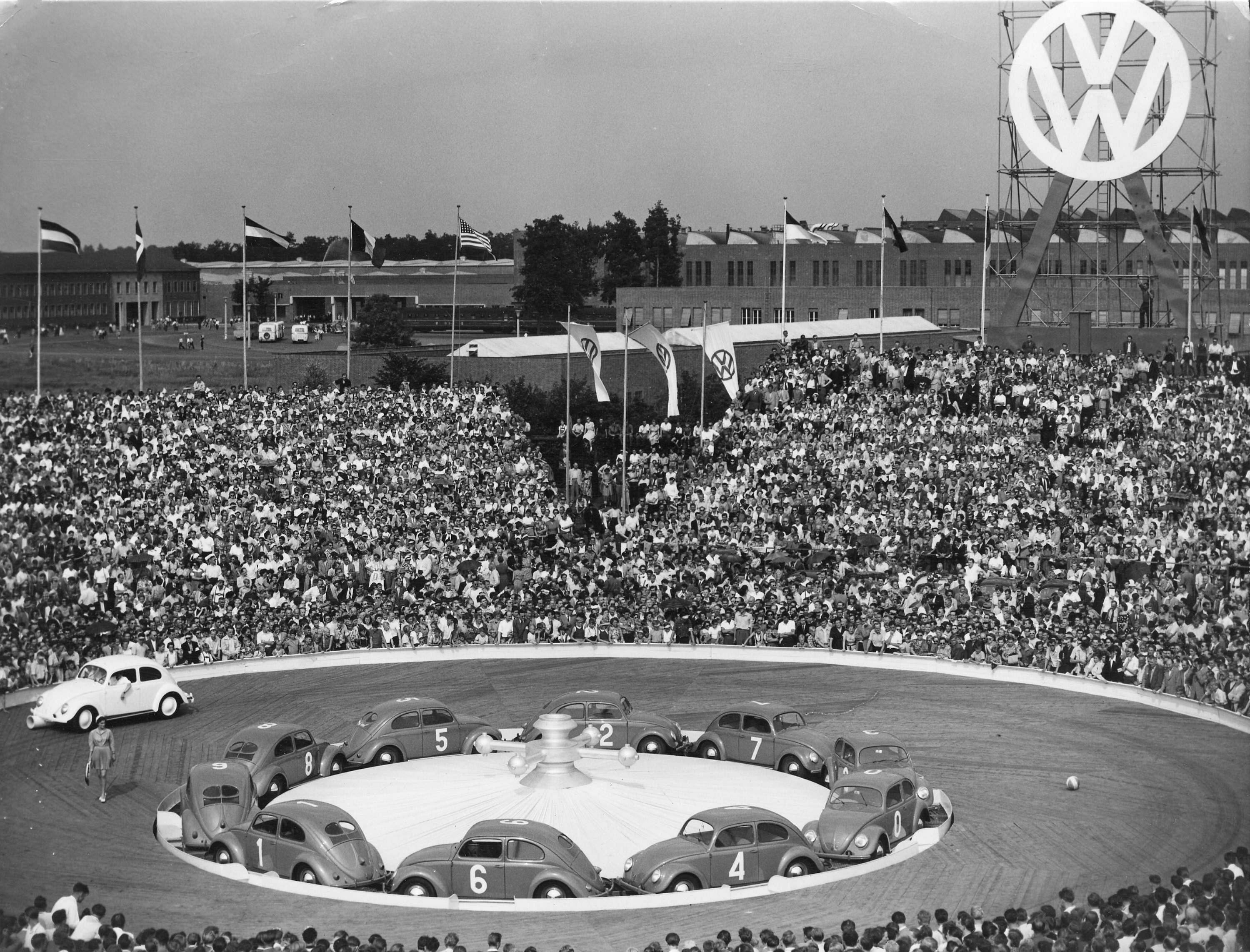 In this July 7, 1953 file photo, to celebrate the 500,000 produced Volkswagen Beetle after WW II the company has organized a beetle roulette, with 10 red and green beetles in the Volkswagen stadium in Wolfsburg, West Germany. (File Photo   Associated Press)