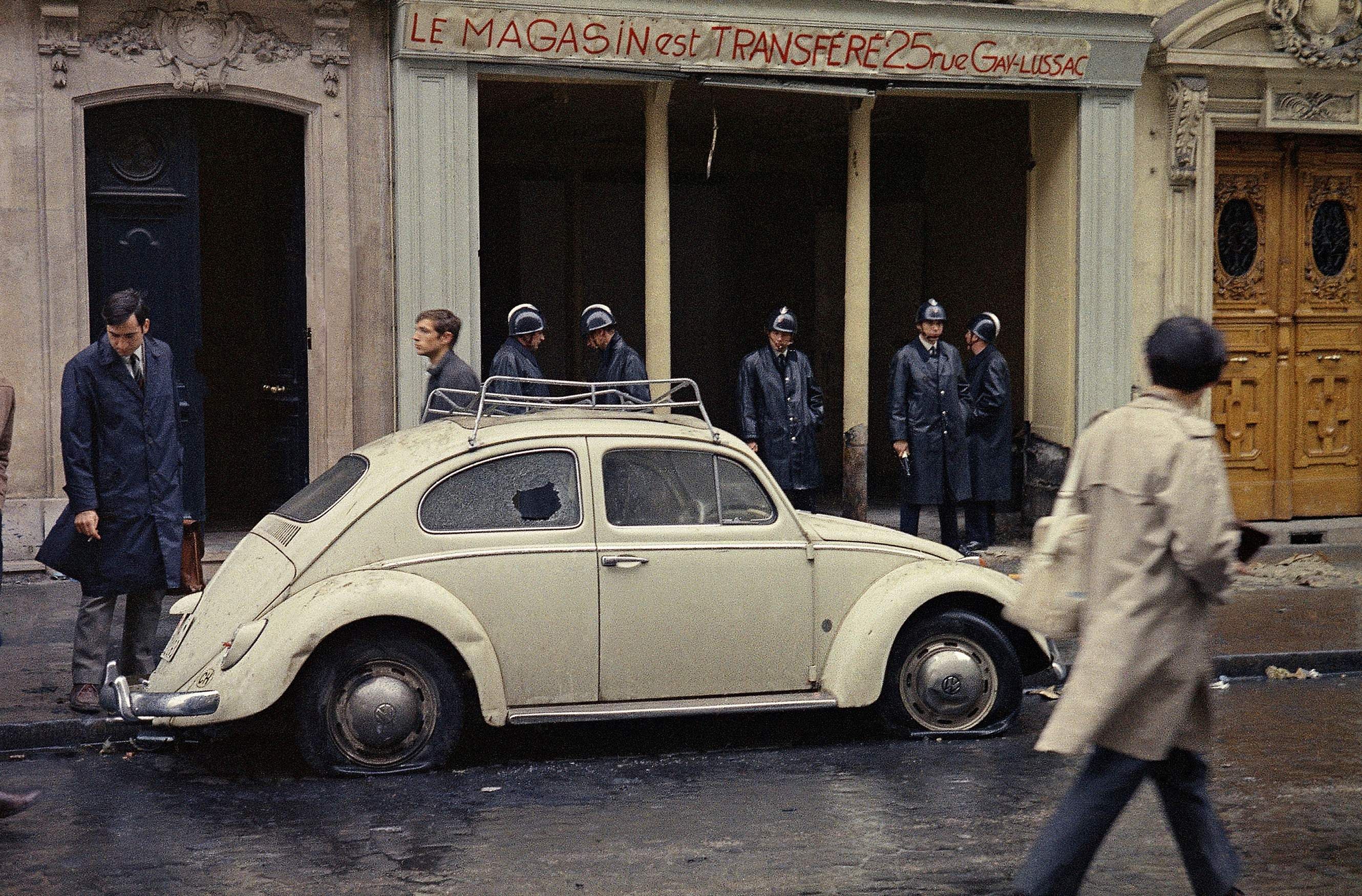 In this May 11, 1968 file photo, Guards stand in front of a shop on a street in the Latin Quarter of Paris, following a student riot and general strike that rocked the city. (File Photo   Associated Press)