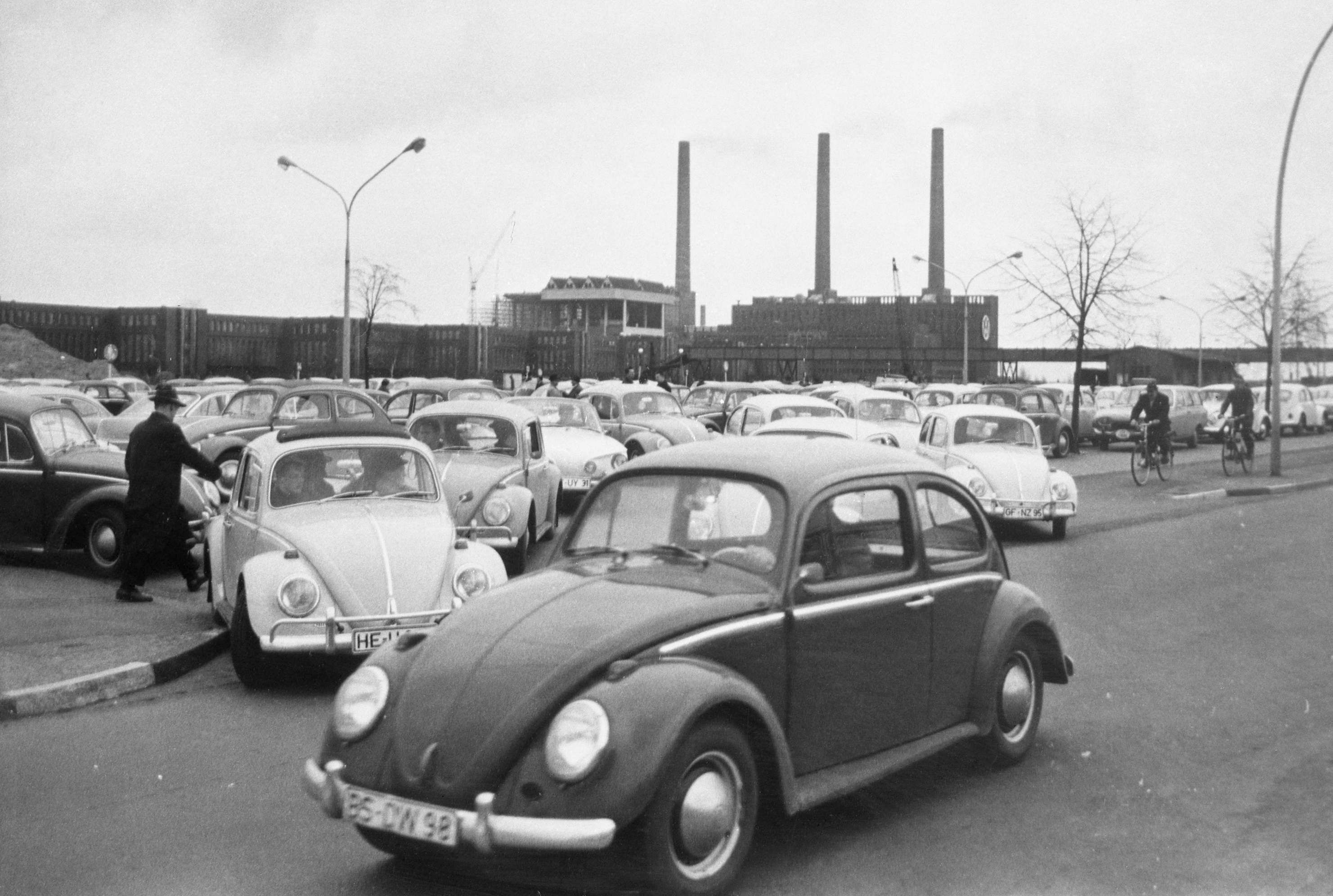 In this April 27, 1966 file photo, Volkswagen workers drive their Beetle cars from the parking lot on their way home at the end of a days work at the world's largest single auto plant, the Volkswagen factory (seen in background) in Wolfsburg, Germany. Volkswagen is halting production of the last version of its Beetle model in July 2019 at its plant in Puebla, Mexico, the end of the road for a vehicle that has symbolized many things over a history spanning eight decades since 1938.(File Photo   Associated Press)