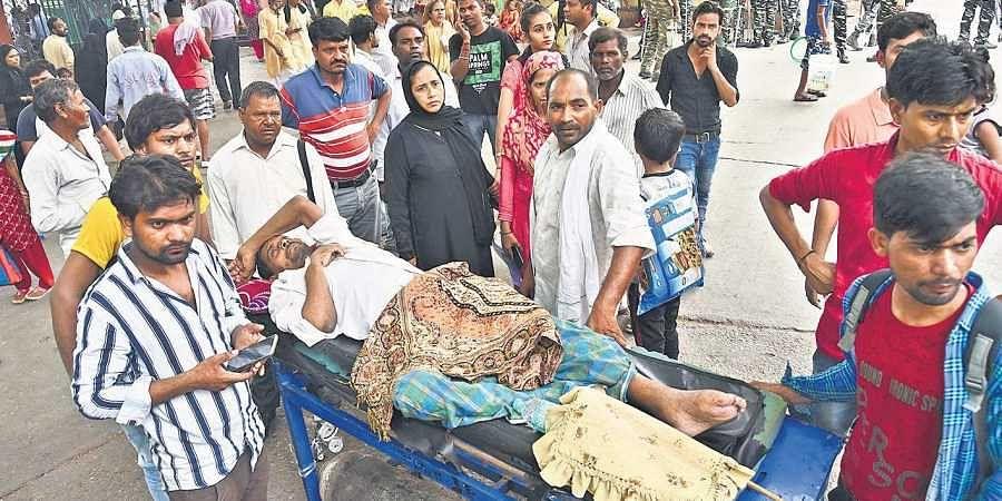 Patients have a hard time as doctors hold a strike at Lok Nayak Jai Prakash Narayan Hospital.