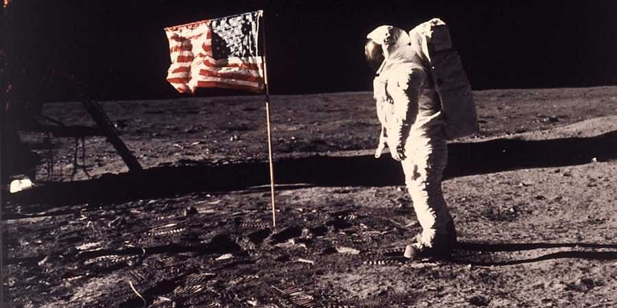 In this image provided by NASA, astronaut Buzz Aldrin poses for a photograph beside the US flag deployed on the moon during the Apollo 11 mission on July 20, 1969.