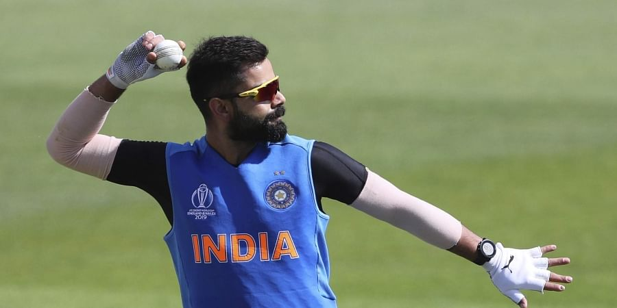 India skipper Virat Kohli prepares to throw the ball during a training session ahead of their Cricket World Cup match against South Africa at Ageas Bowl in Southampton, England.