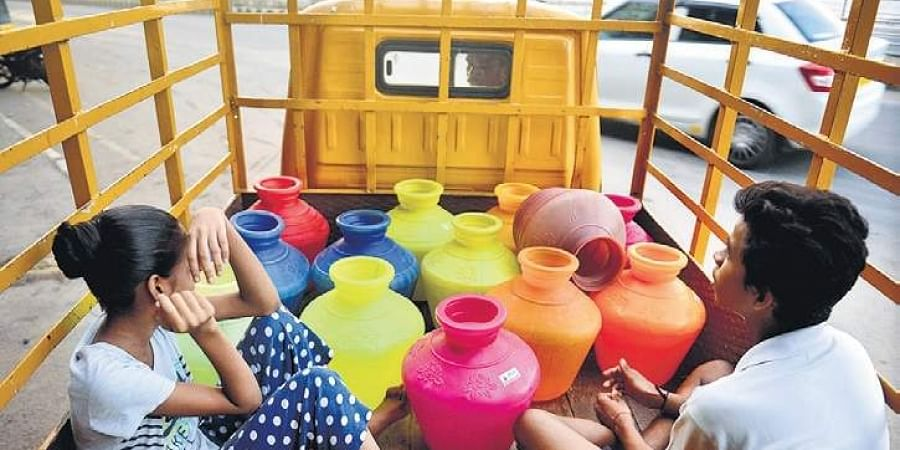 Water starved residents of Chennai collect as much drinking water as possible from a government-run Metro Water filling station in the city. ( Photo | EPS)