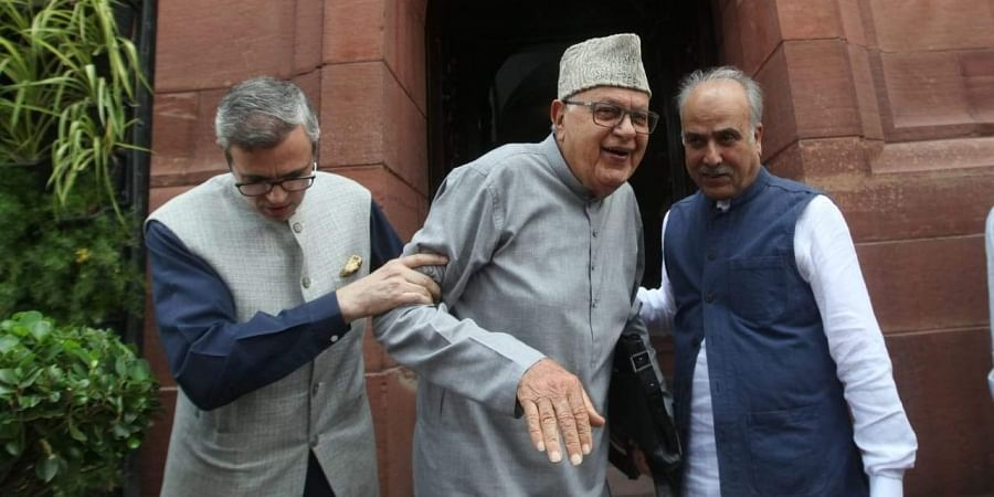 Jammu Kashmir National congress leader Farooq Abdullah and Omar Abdullah after meeting the Prime Minister Narendra Modi at parliament House in New Delhi on Thursday